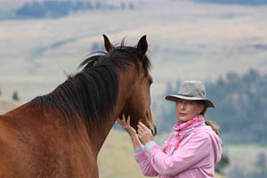 Margrit Coates and Horse with view